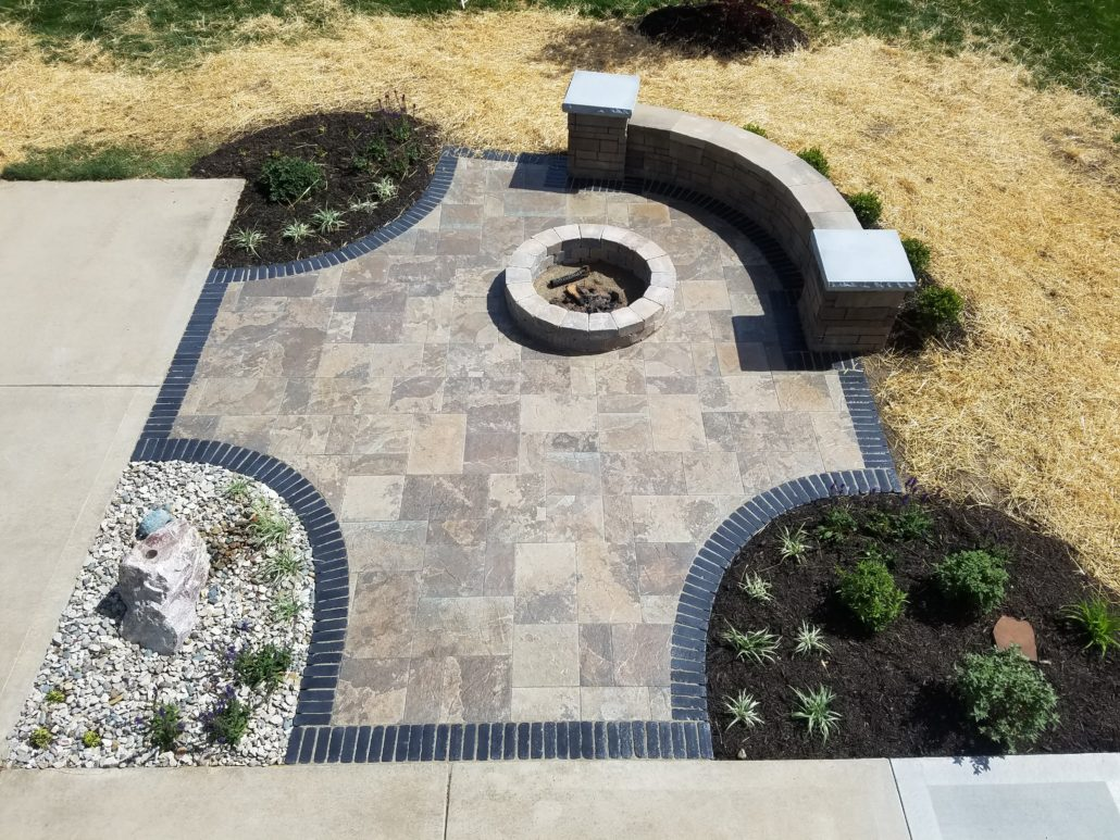 Landscaping With Paver Patio Fire Pit And Sitting Wall In Kansas City